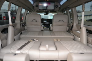 Rear Power Sofa that makes into a Bed or lays flat for Extra Cargo room 2021 Explorer Van Company