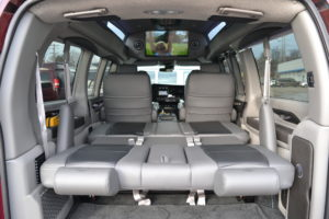 Rear Power Sofa that makes into a Bed or lays flat for Extra Cargo room Explorer Van Company