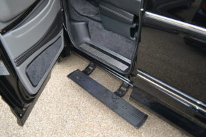Power Retractable Running Boards offer a Large secure step to make it easy to get in your van. Explorer Van Company