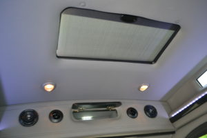 Power Rear Sunroof with Closed Sunshade & Open Rear Storage Cabinet. Explorer Van