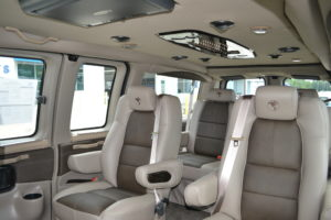 Tan Leather Seats with new Saddle Inserts Black Burl Hi Gloss Wood and Accent Trim Conversion Van Land