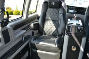 Relax with Massaging Seats, Power Footrest Recliner & more Explorer Van Executive Package