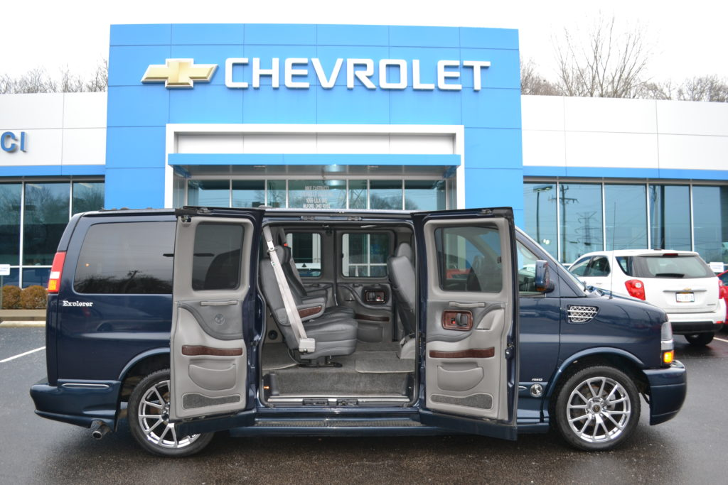 0628225b1b46 Dark Blue Metallic AWD Explorer Low Top Van Mike Castrucci Chevrolet  Conversion Van Land